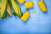Ripe Corn On A Blue Table Close-up. Yellow Ripe Corn, Top View poster