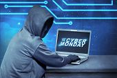 Hacker Using Laptop With Text Cyber Monday On The Screen. Cyber Monday Concept poster