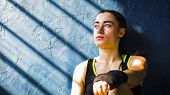 Portrait Beautiful Young Boxing Woman Resting After Training After Punching In Gym. Fit Female Prepa poster