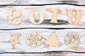 Wooden Number 2019 And New Year Figures. New Year Number 2019 From The Wooden Digits And Carved Wood poster