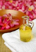 picture of massage oil  - Massage oil on white towel - JPG