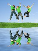 stock photo of triplets  - happy kids or children playing and fun jumping for joy - JPG