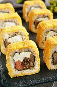 Hot Crispy Deep Fried Sushi Rolls with Salmon and Philadelphia Cream Cheese Inside. Tempura Maki Set poster
