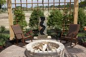 picture of pergola  - Beautiful backyard with a cozy fire pit and fountain - JPG