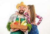 Father Farmer Or Gardener With Daughter Hold Basket Harvest Vegetables. Farmers Family Homegrown Har poster