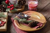 Christmas Setting Table. Dinner Plate, Silverware, Fir Tree, Gift Boxe, Candle And Festive Decoratio poster