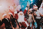 Man In Santa Claus Costume On New Year Party. Happy New Year. People Have Fun. Indoor Party. Celebra poster