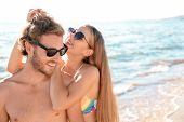 Happy Young Couple In Beachwear Spending Time Together On Seashore. Space For Text poster