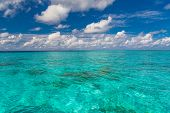 Beautiful White Clouds On Blue Sky Over Calm Sea With Sunlight Reflection. Tranquil Sea Harmony Of C poster