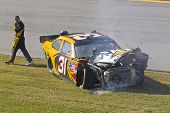 TALLADEGA, AL - OCT 31:  Jeff Burton exits out of his crashed CAT Chevrolet during the AMP Energy Ju
