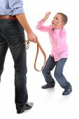stock photo of punishment  - Strict father punishes his son - JPG
