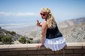 A Female With Curly Hair Admires The Beautiful View Of The Coachella Valley Below, From Keys View Vi poster