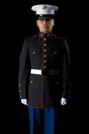 stock photo of united states marine corps  - A United States Marine wearing Dress Blues in a studio environment - JPG