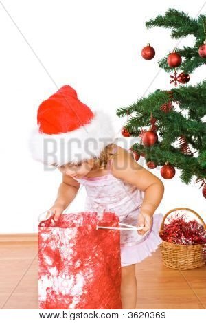 Little Girl With Present And Christmas Tree