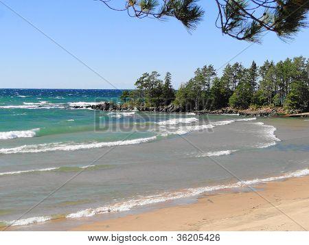 Whitecap Waves on a Sandy Beach