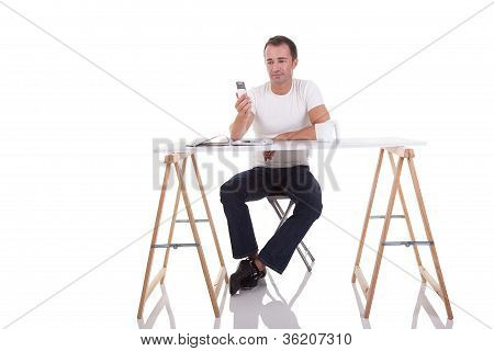 Man At The Desk And On The Phone, Isolated On White, Studio Shot