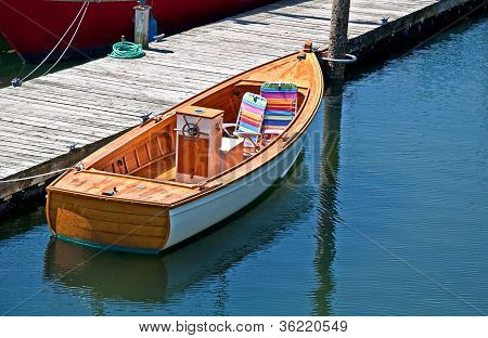 Small Dinghy Boat Tied At Dock
