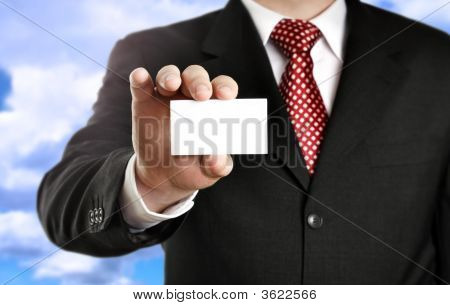 Businessman Showing His Business Card, Focus On Fingers And Card.