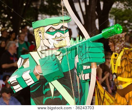 A comic book fan dressed as Green Arrow marches in the annual DragonCon parade