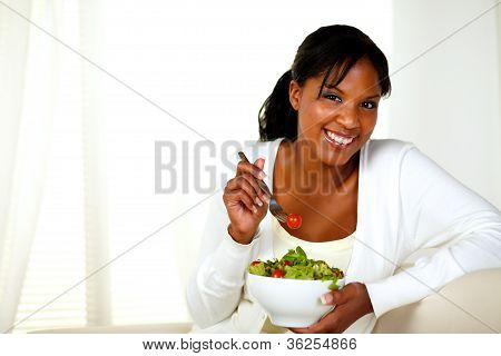 Young Woman Smiling And Eating A Vegetable Salad
