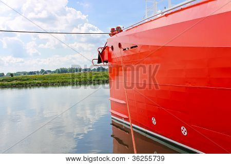 Bow Of New Red Ship At The Port