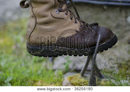 A Leather Walking Boot, Being Cleaned On An Old Cast Iron Boot S