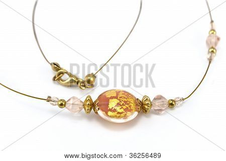 Pendant On Golden Necklace