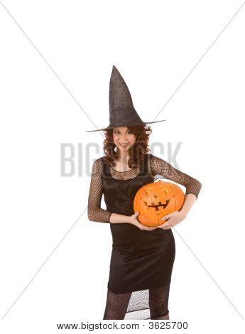 Teenaged Girl In Halloween Costume With Pumpkin(Focus On Pumpkin)