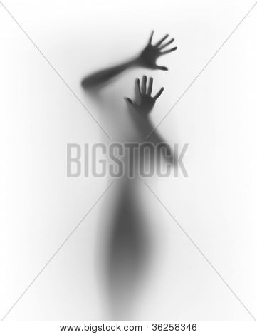Scary human silhouette behind a diffuse surface