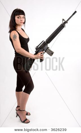 Girl With Gun And Headphones.