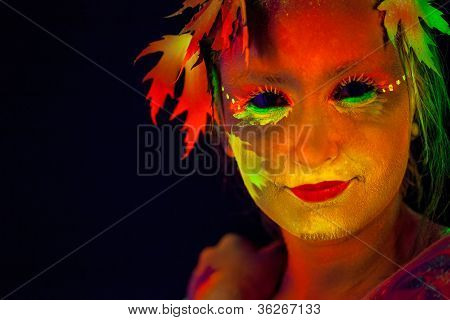 Woman's face with bodyart