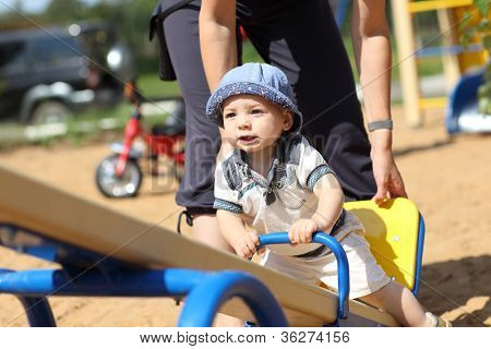 Baby Boy On Seesaw
