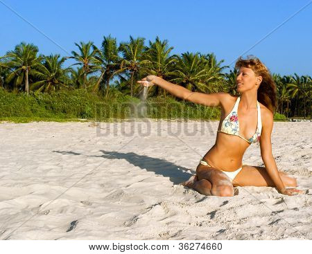Woman In Bikini Enjoy On A Tropical Beach