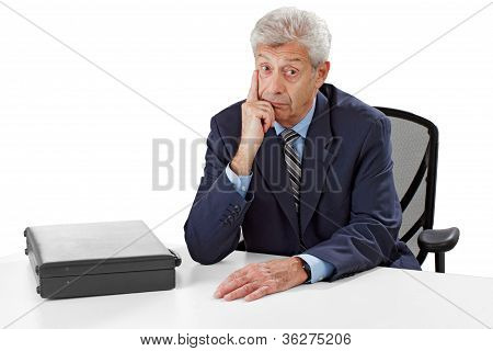Attentive Senior Business Man Listens With Hand On Chin