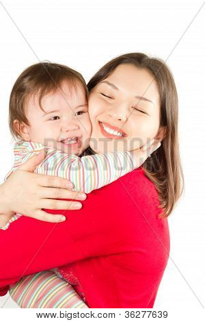 Happy Mom And Baby Girl Hugging And Laughing.the Concept Of Childhood And Family