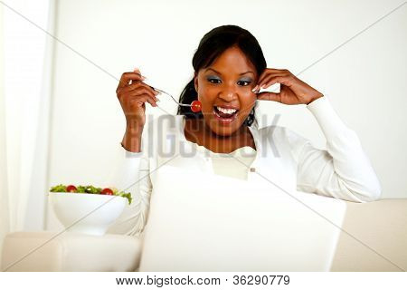 Surprised Young Woman Eating Fresh Vegetable Salad