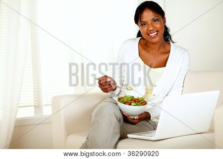 Young Woman Eating Healthy Salad Looking At You