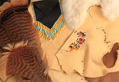 stock photo of buckskin  - Creating Native American Art and Accessories with Feathers leather and beads - JPG