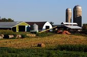 picture of silos  - farm in the countryside with farm equipment machinery and silo - JPG