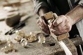 image of wood craft  - Hands of a carpenter planed wood workplace - JPG