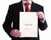pic of citizenship  - Man in black suit holding Australian Citizenship Certificate on isolated white background - JPG