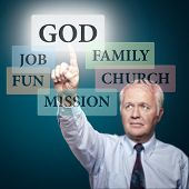 stock photo of priorities  - Senior pastor showing the priorities in our life - JPG