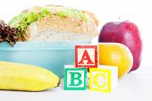 stock photo of tupperware  - Shot of school lunch with alphabet blocks - JPG