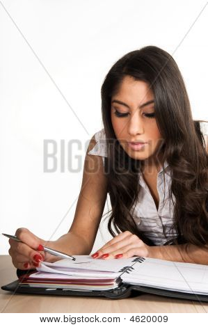 Beautiful Girl Focused On Her Planner
