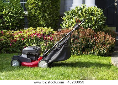 Old Lawnmower On Front Yard Ready For Work