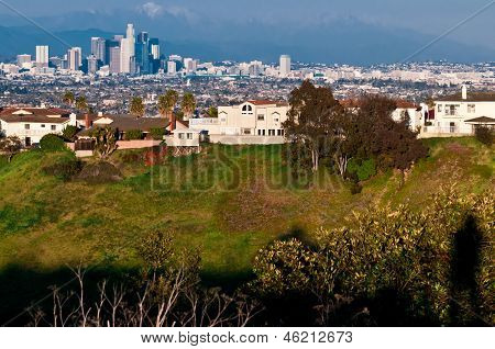 Shadow of person looking into th beautiful LA cityscape with mou