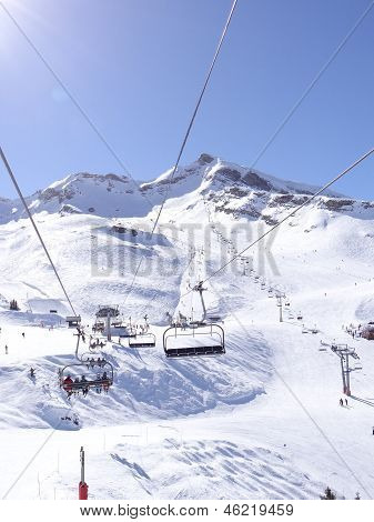 Ski Lift Carries Skiers