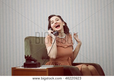 Cheerful Woman Talking On Landline Phone
