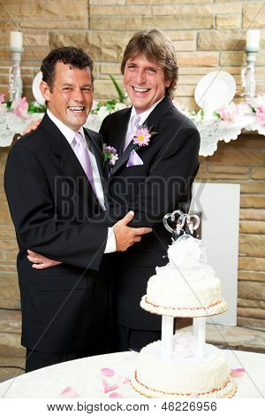 Two handsome, happy grooms enjoying their wedding reception.