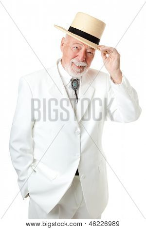 Handsome Southern senior man tipping his hat, with old fashioned chivalry.  Isolated on white.